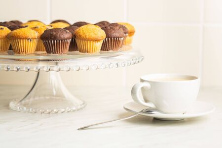 Sweet muffins. Chocolate cupcakes on kitchen table. Archivio Fotografico - 139619594
