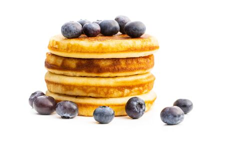 Sweet homemade pancakes and blueberries isolated on white background. Archivio Fotografico - 139887410