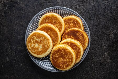 Sweet homemade pancakes on old kitchen table. Archivio Fotografico - 139887556