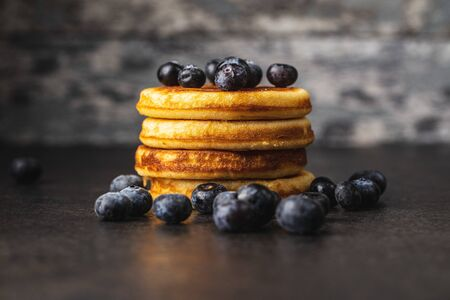 Sweet homemade pancakes and blueberries on old kitchen table. Archivio Fotografico - 139887555
