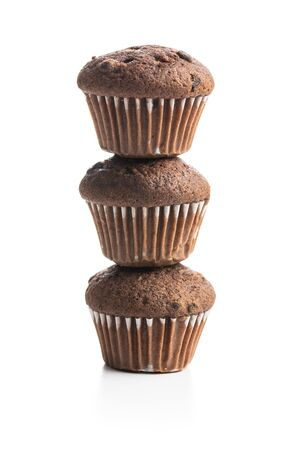 Sweet muffins. Cupcakes with chocolate isolated on white background. Archivio Fotografico - 140134708