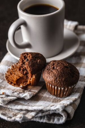 Tasty chocolate muffins. Sweet cupcakes and coffee cup.