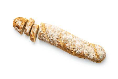 Fresh whole grain bread baguette isolated on white background. Foto de archivo
