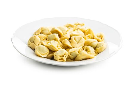 Tortellini pasta on plate. Italian stuffed pasta isolated on white background.