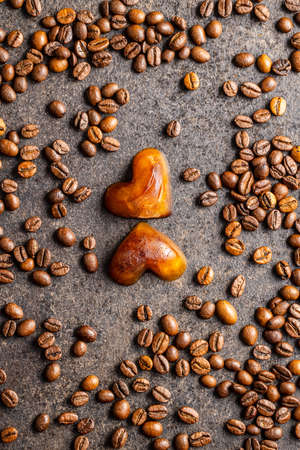 Frozen coffee shaped like heart. Coffee ice cubes and coffee beans. Top view. Imagens