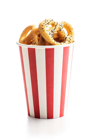 Crispy salted pretzels in paper cup isolated on white background Imagens