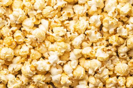 Sweet tasty popcorn. Background texture.