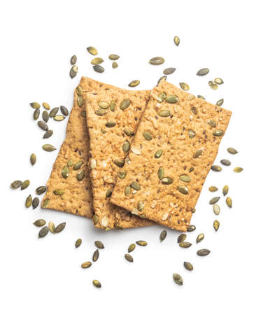The crispy bread with pumpkin seeds. Knackebrot isolated on white background.