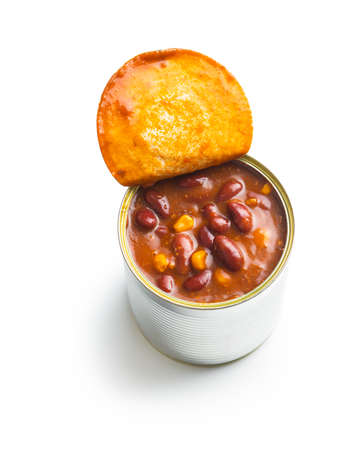 Chili with meat. Mexican food with beans in can isolated on white background. Banque d'images