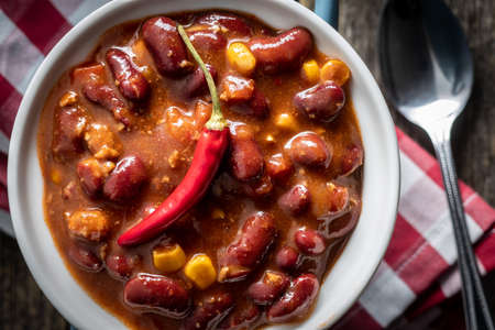 Chili with meat. Mexican food with beans in pot. Top view.