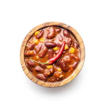 Chili with meat. Mexican food with beans in wooden bowl isolated on white background. Banque d'images