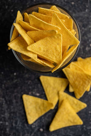 Salted tortilla chips on black table. Top view. Banque d'images