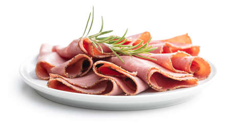 Sliced beef ham on plate isolated on white background.