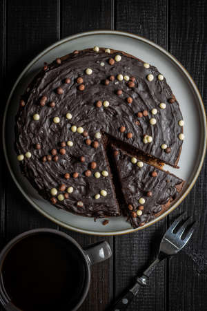 Sweet chocolate cake on black table. Top view. Imagens
