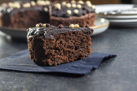 Piece of chocolate cake black table.