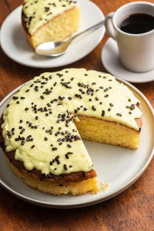 Sweet lemon cake on wooden table.