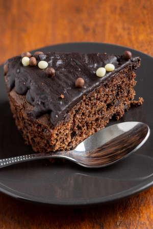 Piece of chocolate cake on dessert plate. 免版税图像