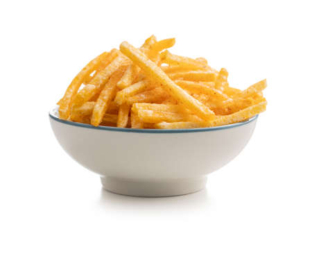French fries in bowl. Fried mini potato sticks isolated on white background.