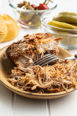 Pulled pork meat on plate.