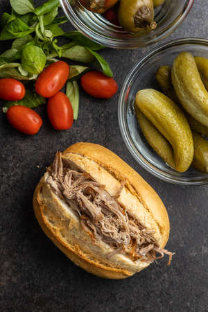 Sandwich with pulled meat on black table. Top view. Imagens