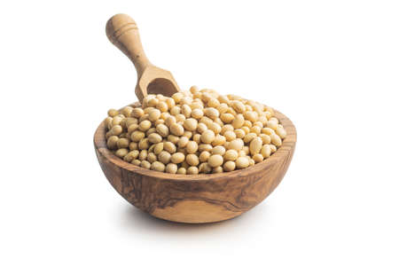 Dried soy beans in a wooden bowl isolated on a white background. Banco de Imagens