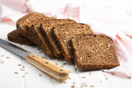 Dieting cereal bread with sunflower seeds on white table. 版權商用圖片