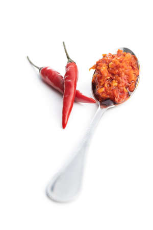 Red hot chili paste in spoon isolated on white background. 版權商用圖片 - 161522582