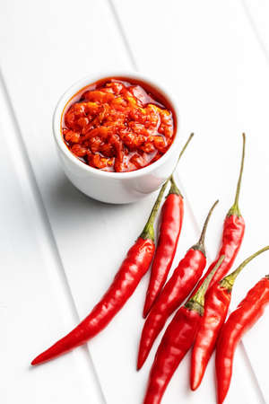 Red hot chili paste and chili pepper on white table. 版權商用圖片 - 161522655