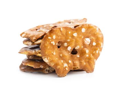 Salted mini flat pretzels isolated on white background. 版權商用圖片