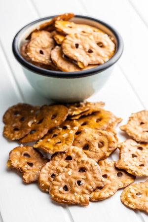 Salted mini flat pretzels on white table. 版權商用圖片 - 161648260