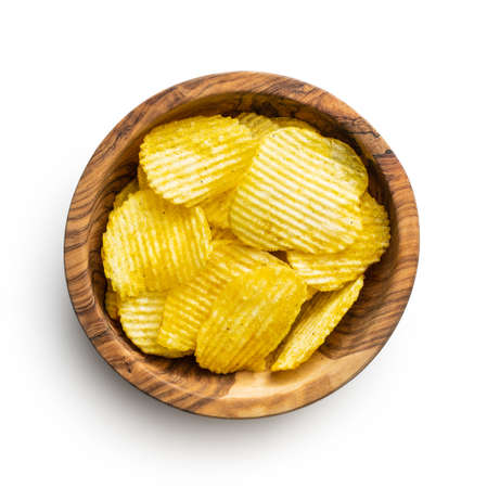 Crispy potato chips in bowl isolated on white background.