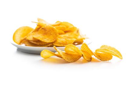Crispy potato chips isolated on white background.
