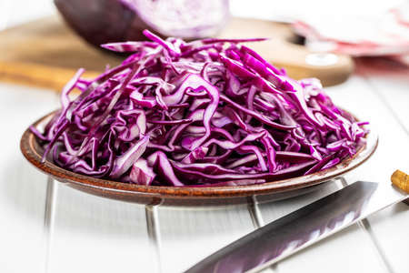Sliced fresh red cabbage on plate.