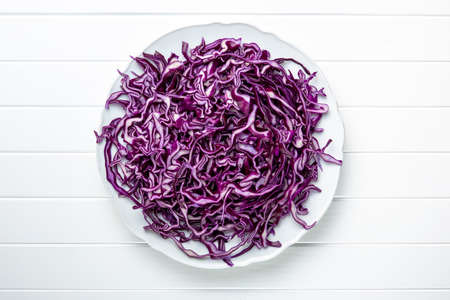 Sliced fresh red cabbage on plate. Top view.