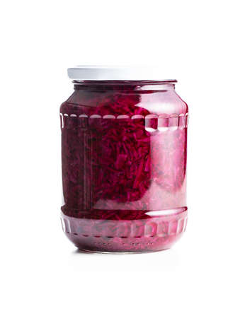 Red sauerkraut. Sour pickled cabbage in jar isolated on white background.