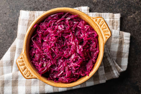 Red sauerkraut. Sour pickled cabbage in bowl. Top view.
