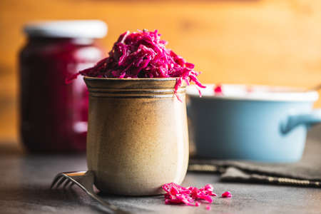 Red sauerkraut. Sour pickled cabbage in a cup. 版權商用圖片