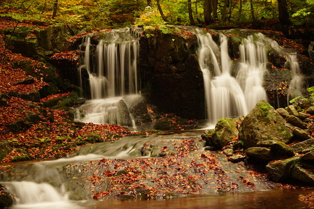Small waterfall on a creek Ponikly in mountains Jeseniky  photo