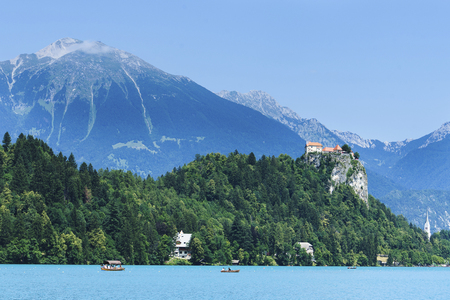 The most visited and well-known place, one of the symbols of Slovenia, is Lake Bled surrounded by mountains with an island in the middle. Фото со стока