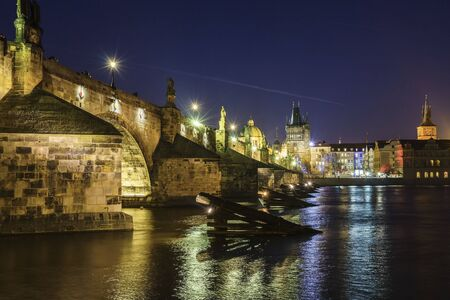 Charles Bridge is the oldest standing bridge across the Vltava River in Prague and the second oldest bridge in the Czech Republic. Фото со стока