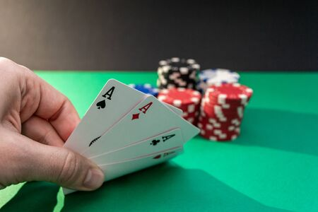 pair of aces, looking at the cards during the game. Poker texas holdem