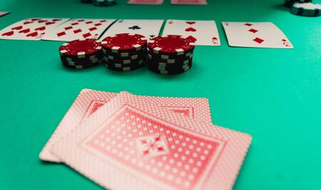 foreground poker cards and chips in the middle of the game. texas holdem