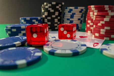 Cards, dice and poker chips on a green table. Casino concept Reklamní fotografie