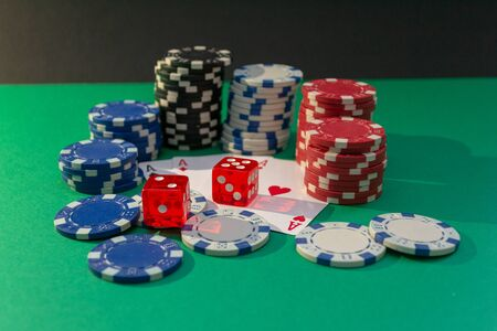 Cards, dice and poker chips on a green table. Casino concept Stock Photo