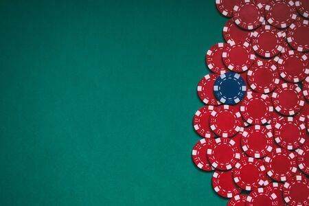 green poker table with red chips and a blue one in the middle. With space for texts