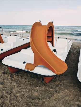 pedal boat parked on the beach. Games on vacation Archivio Fotografico