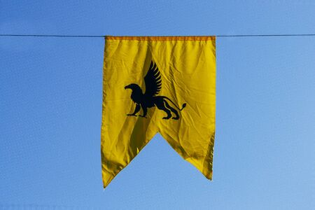yellow chimera banner with blue sky in the background. Medieval concept Banque d'images