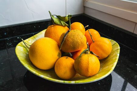 Close-up of fruit bowl with oranges. Real food concept