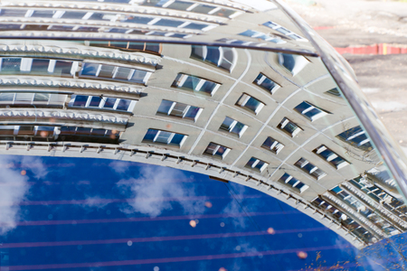 reflectivity: Multi-storey contemporary house reflected in the window of the car