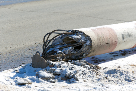 electric avenue: Concrete electric pole fell next to the road (emergency power supply) Stock Photo